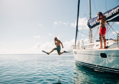 Dive from the side of the yacht on your sailing and snorkeling trip